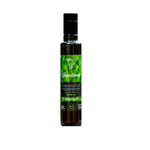 """The olive oil """"jewel"""" Gemstone blend evoo, belongs to the category of multicultural gourmet olive oils, where with the combination of its ingredients and the global uniqueness in its production, it is a tasting experience of high gastronomy, a delicious trip around the world.  Gemstone blend evoo is one of the leading multi-varietal """"jewels"""" of the new series of innovative olive oils, Sakellaropoulos organic farms, called """"Olive Oil Jewels"""".  Released in 2019, it was awarded worldwide, with its distinction as the No. 1 olive oil in the world for 2019."""