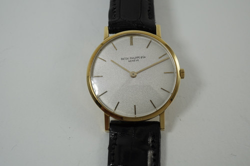 Patek Philippe 3512 Calatrava slim 18k yellow gold dates 1960-65 pre owned for sale houston fabsuisse