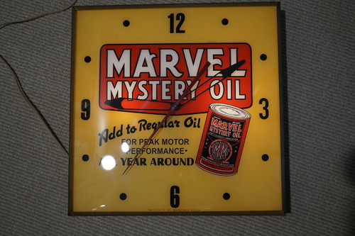 Marvel Mystery Oil Advertising Clock by Auto PAM dates 1960's vintage light up wall clock pre owned for sale houston fabsuisse