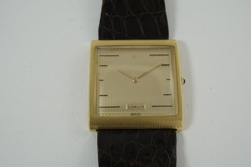 Corum Buckingham 18k yellow gold large case dates 1970's vintage original pre owned for sale houston fabsuisse