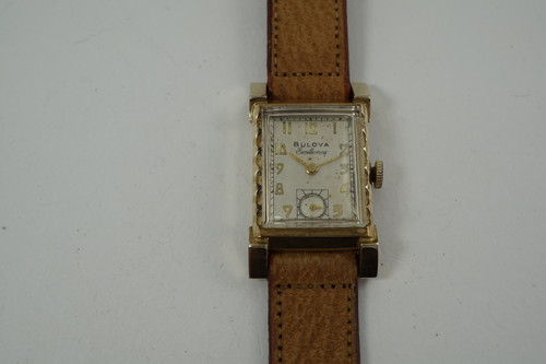Bulova Excellency U.S.A. 10k yellow gold filled fancy case dates 1940's vintage pre owned for sale houston fabsuisse
