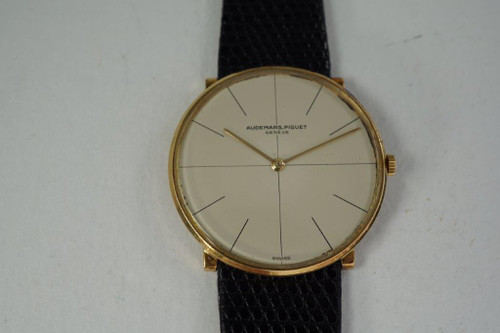 Audemars Piguet Slim Round 18k yellow gold dress watch dates 1966 vintage pre owned for sale houston fabsuisse