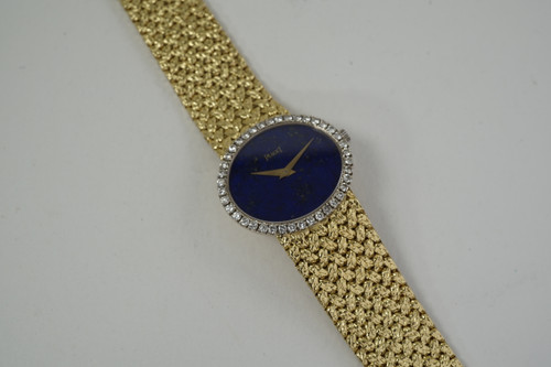Piaget Bracelet watch 18k yellow gold & diamonds w/ lapis dial c. 1970's vintage pre owned for sale houston fabsuisse