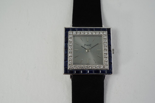 Piaget Dress Watch 18k white gold facotry sapphires  & diamond bezel rare c. 1970's pre owned vintage for sale houston fabsuisse