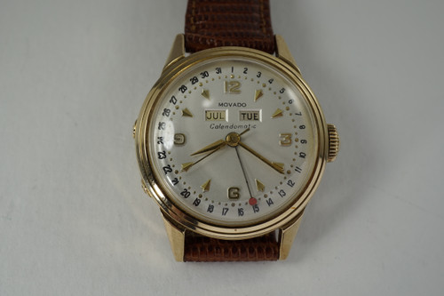 Movado Calendomatic 14k yellow gold automatic dates 1950's vintage pre owned for sale houston fabsuisse