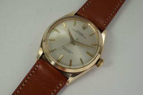 Rolex 6564 Chronometer 14k yellow gold dates 1959 automatic vintage pre owned for sale houston fabsuisse