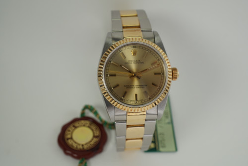 Rolex 67513 Oyster Perpetual stainless steel & 18k yellow gold 30 mm c. 1991 automatic pre owned for sale houston fabsuisse