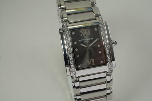 Patek Philippe 4910 Twenty 4 stainless steel w/ diamond bezel c. 2000's pre owned modern for sale houston fabsuisse