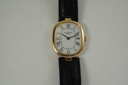Patek Philippe 4554 Ladies Ellipse 18k yellow gold dates 1990's modern pre owned for sale houston fabsuisse