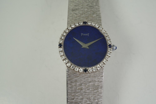 Piaget 9706 A6 Diamond Bracelet Watch factory lapis dial dates 1970's 18k white gold vintage pre owned for sale houston fabsuisse