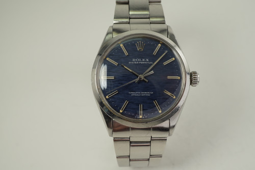 Rolex 1002 Oyster Perpetual stainless steel blue mosaic dial dates 1970 vintage pre owned for sale houston fabsuisse