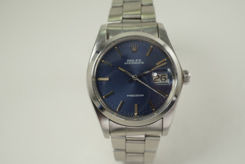 Rolex 6694 Oyster Date Precision Original blue dial 35 mm dates 1975 stainless steel vintage pre owned for sale houston fabsuisse