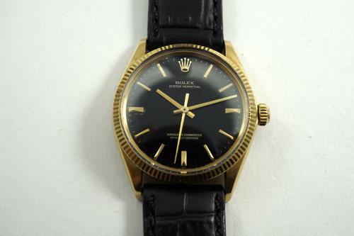 Rolex 1005 Oyster Perpetual 18k stunning black gilt dial c. 1963 pre-owned for sale houston fabsuisse