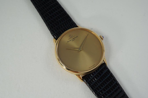 Baume Mercier Wristwatch 18k yellow gold round dates 1980's