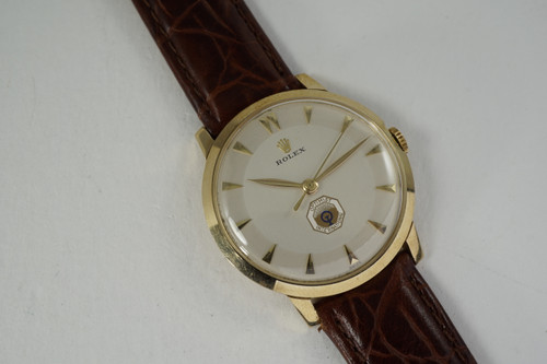 Rolex Logo watch 14k yellow gold dress model dates 1970'S pre-owned for sale houston fabsuisse