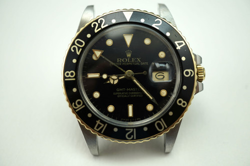 Rolex 16753 GMT steel & 18k w/original papers and card c.1985 for sale Houston pre-owned Fabsuisse