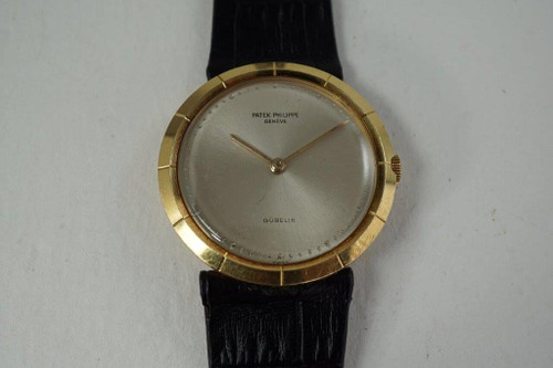 Patek Philippe 3459 retailed by Gubelin 18k yellow gold dates 1960's pre owned for sale houston fabsuisse
