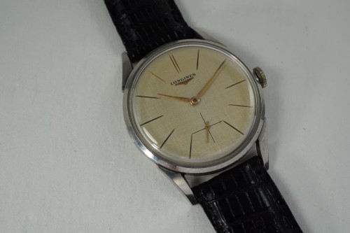 Longines 7111-2 large stainless steel linen dial wristwatch dates 1959 pre owned for sale houston fabsuisse