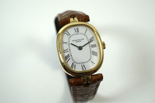 Patek Philippe 4464 Ellipse ladies 18k yellow gold dates 1980's for sale houston fabsuisse