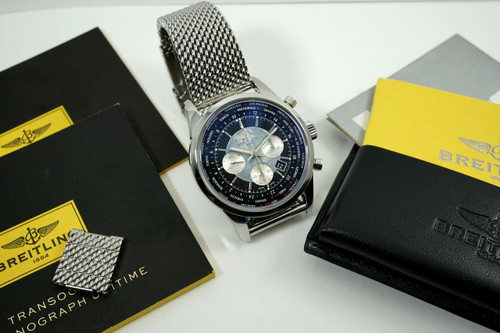 Breitling AB0510 Transocean Unitime Chronograph World Time box & papers for sale houston fabsuisse