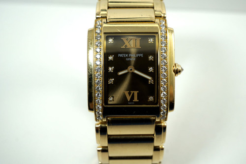 Patek Philippe 4910/11R twenty 4 ladies 18k rose gold 7 diamonds dates 2000's pre owned modern timepiece for sale houston fabsuisse
