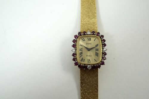 Piaget Bracelet Watch boutique style ruby & diamond ladies 18k yellow c. 1970's pre owned for sale houston fabsuisse