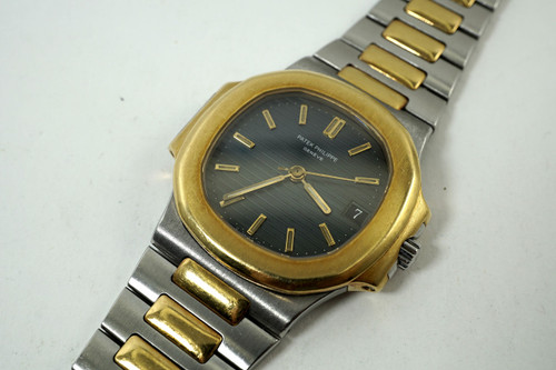 Patek Philippe 3800/1 Nautilus steel & 18k yellow gold orginal with date automatic dates 1990's for sale houston fabsuisse
