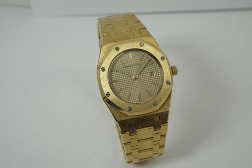 Audemars Piguet Roayl Oak 18k yellow gold 30 mm dates 1980's original for sale houston fabsuisse pre owned vintage