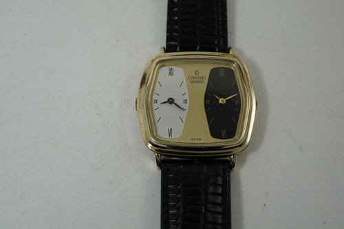 Concord 2-Time Zone 14k yellow gold dates 1990's quartz modern travelinConcord 2-Time Zone 14k yellow gold dates 1990's quartz modern traveling watch pre owned for sale houston fabsuisseg watch pre owned for sale houston fabsuisse
