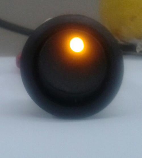 Single pole On-Off Black round Rocker, Amber Dot LED, 187 tabs,