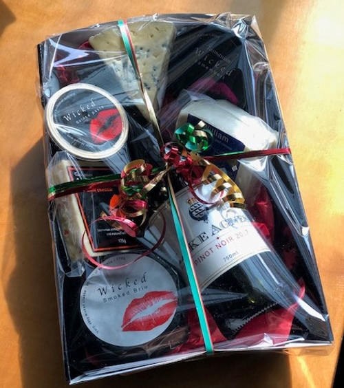 Example of a gift wrapped hamper. Packaging size fits a 5 kilo poly (internal measurements 8.5 x 35 x 25 cm).