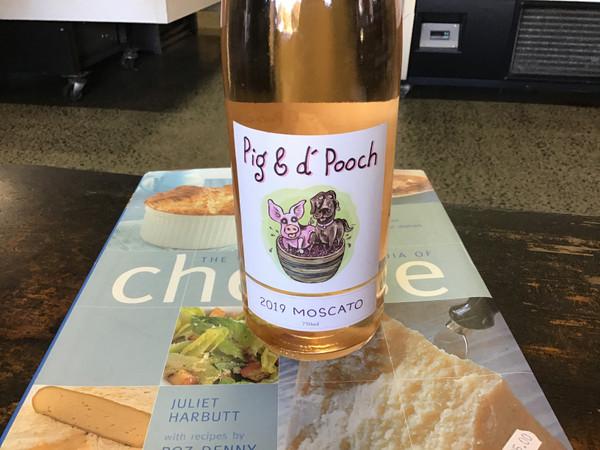Holm Oak Pig and D'Pooch Moscato bottle