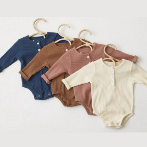 Organic cotton unisex babygrows with long sleeves and 3 buttons at the front, in navy, chocolate, dusky pink and cream