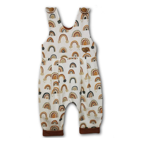 Sleeveless baby romper with all-over rainbows pattern