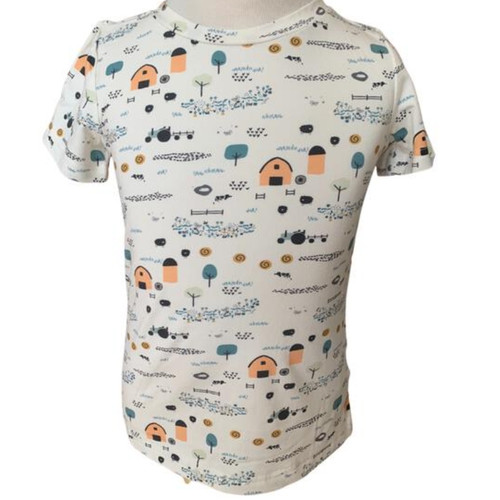 Toddler tee with farm buildings and animals print, seen on a model