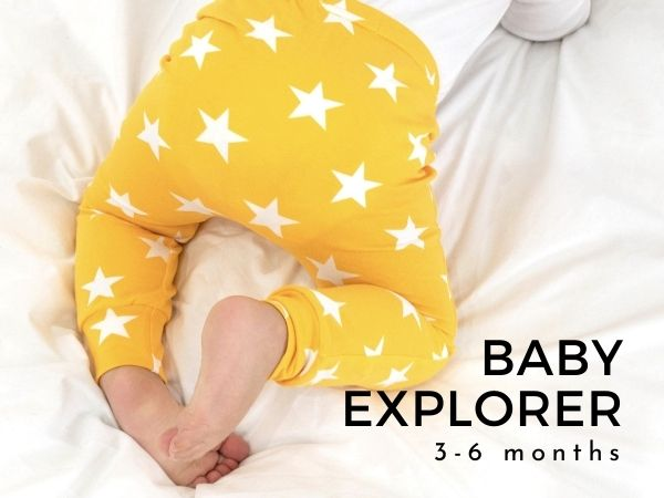 Image of young baby wearing unisex yellow star leggings with text Baby Explorer 3-6 months