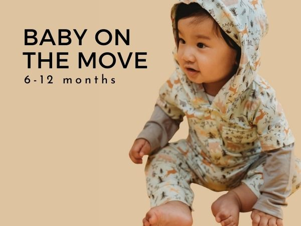 Cute image of young baby sitting up in hooded unisex romper with text Baby on the Move 6-12 months