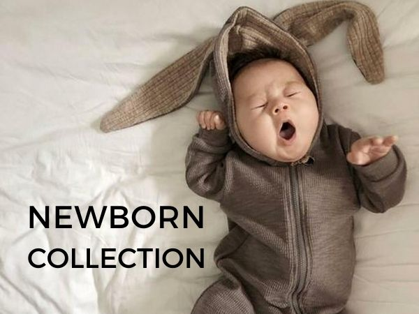 Cute image of newborn baby in unisex bunny sleepsuit with text Newborn Collection