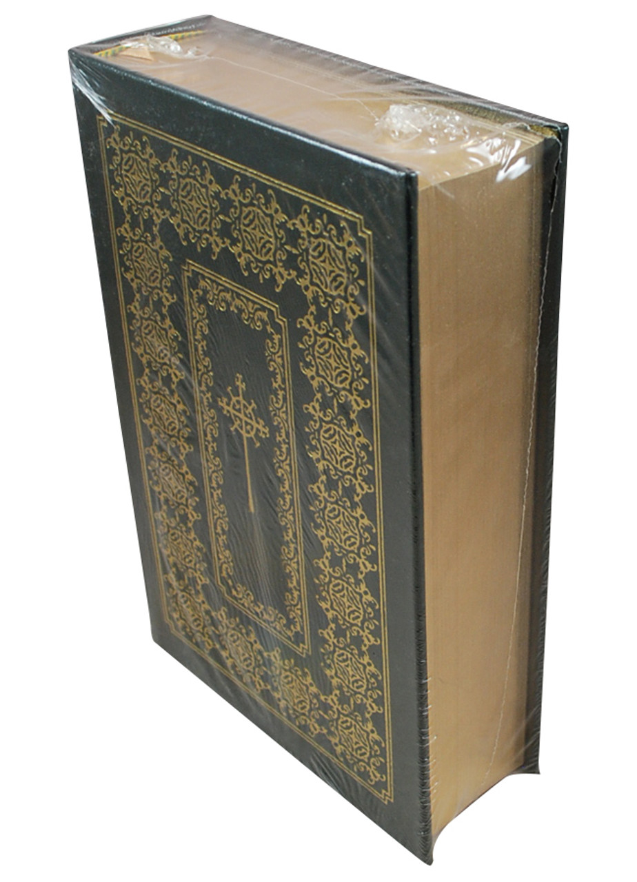 Front side of the book Catechism of the Catholics with pages showing
