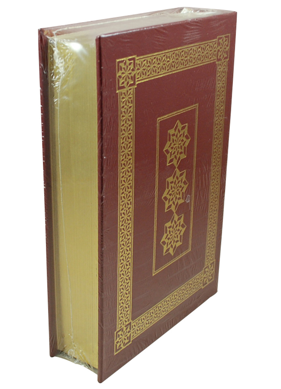 Front image of Einstein His Life and Universe with pages exposed. Maroon book with gold rim