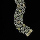 Laurel Leaf Bracelet handmade in Sterling Silver, 18 k Gold, Enamel, Rhodolite Garnet, Peridot, Blue Topaz by Bowman Originals, Sarasota, 941-302-9594.
