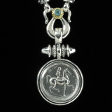 Lady Godiva Necklace Pendant handmade in Sterling Silver, 18 k Gold and accented with Blue Topaz by Bowman Originals, Sarasota, 941-302-9594.