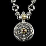 Sundial Necklace handmade in Silver, Gold, Diamond, Garnet by Bowman Originals, Sarasota, 941-302-9594.