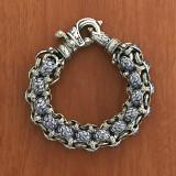 "Rolled Laurel Leaf ""Hook"" Bracelet handmade in Sterling Silver and accented with Vitreous Cobalt Blue Enamel by Bowman Originals, Sarasota, 941-302-9594"
