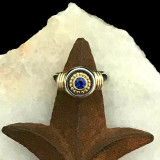 Sterling Silver and 18 k Gold Ring featuring a fine Cornflower Blue Sapphire handmade by Bowman Originals, Sarasota, 941-302-9594.