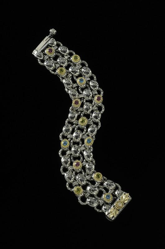 Handmade link Laurel Leaf Bracelet in Sterling Silver, 18 k Gold, Enamel, Rhodolite Garnet, Blue Topaz by Bowman Originals, Sarasota, 941-302-9594.
