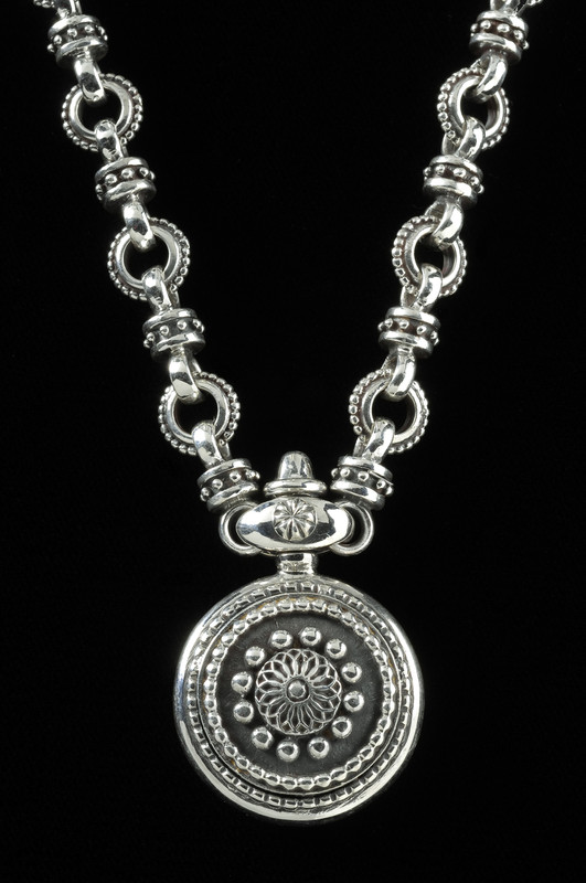 Custom handmade Silver Sundial Necklace by Bowman Originals, Sarasota, 941-302-9594.