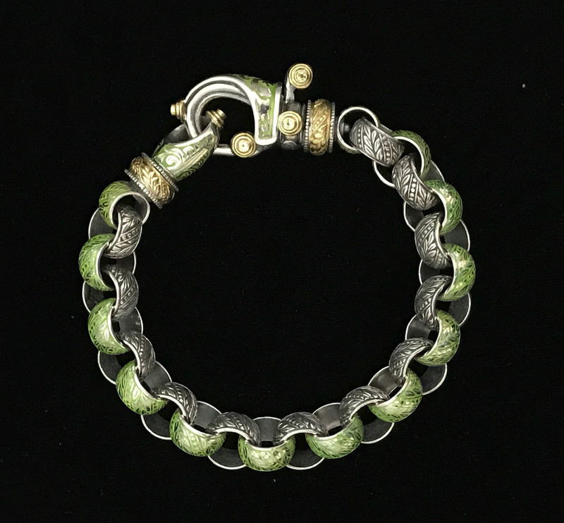 "Laurel Leaf ""Hook"" Bracelet, Silver, Gold, Enamel and Peridot by Bowman Originals, Sarasota, 941-302-9594."