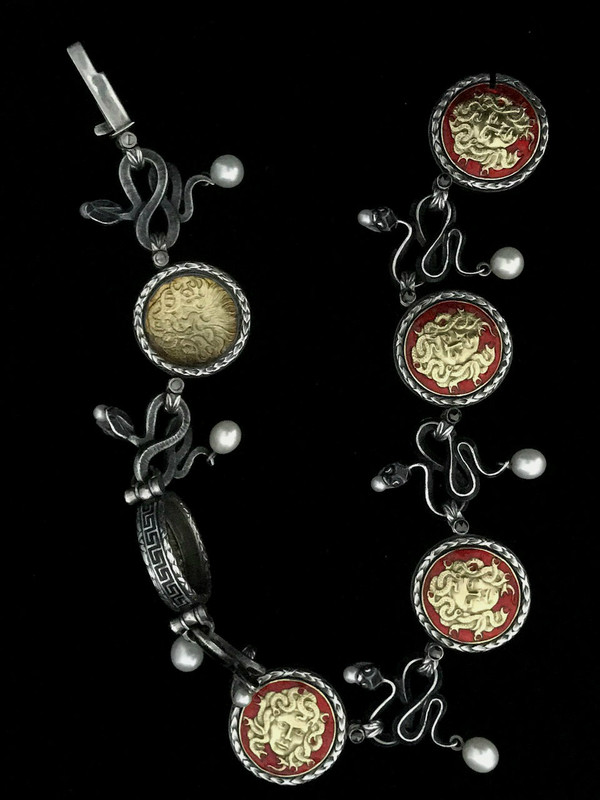 Medusa necklace details in Sterling Silver, 18 k Gold, Enamel, Pearls by Bowman Originals, Sarasota, 941-302-9594.