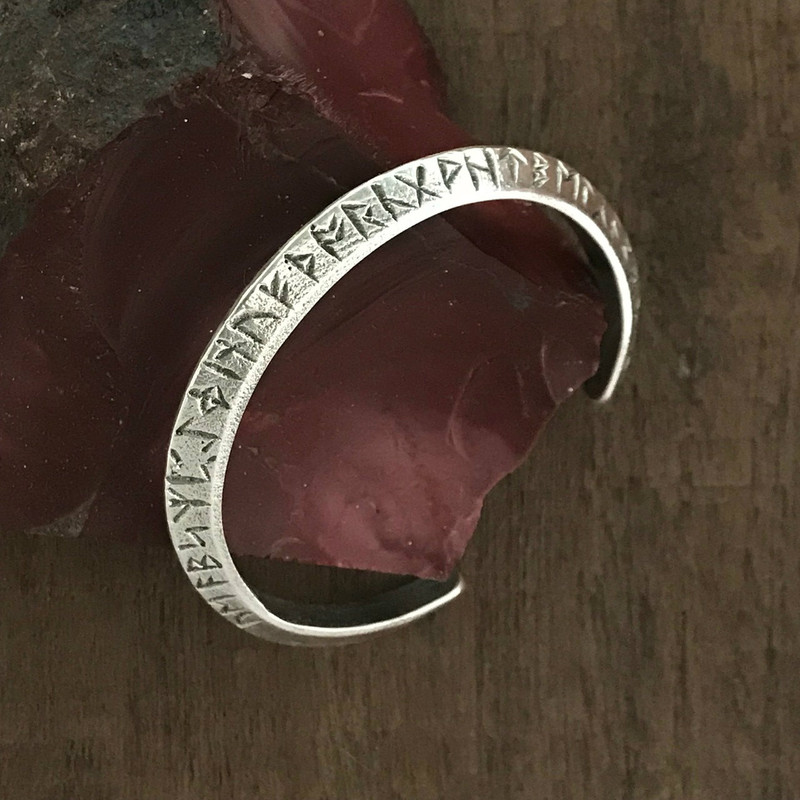 Sterling Silver Cuff Bracelet with ancient Runes handmade by Bowman Originals, Sarasota, 941-302-9594.